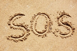 5681206-s-o-s-written-in-the-sand-with-a-finger-or-stick